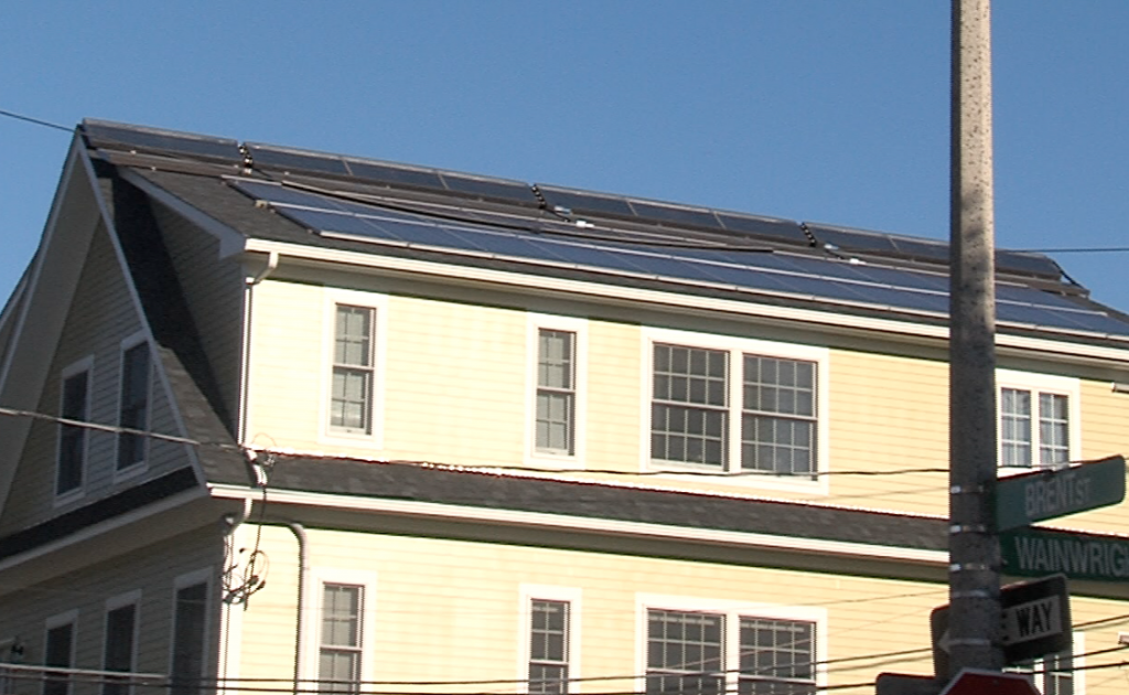 Solar panels on the roof of Loesch and Liriano's home.