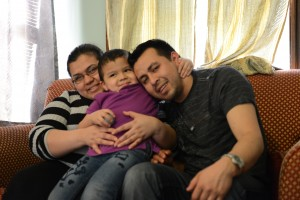 Milton Guevara, his wife and son