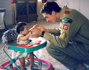 Matt Dalio (right) is playing with a Chinese orphan.