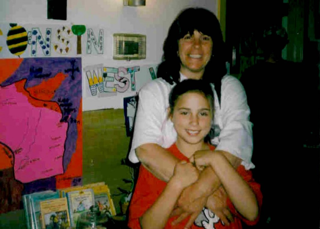 Laura Cole, age 7, posed with her mom at an elementary school function. Photo courtesy of Laura Cole.